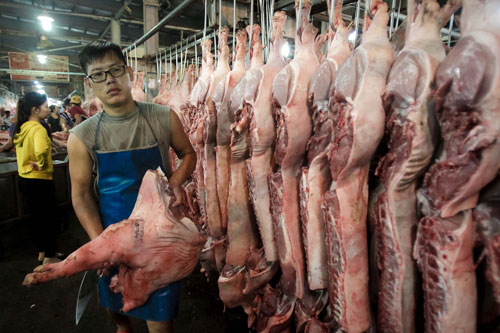 Thịt heo không rõ nguồn gốc vẫn tràn ngập - Ảnh 1.