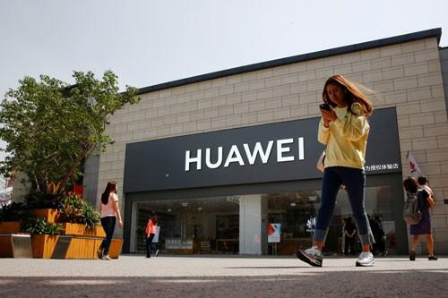 Trung Quốc dọa không ngồi yên vụ Huawei - Ảnh 1.