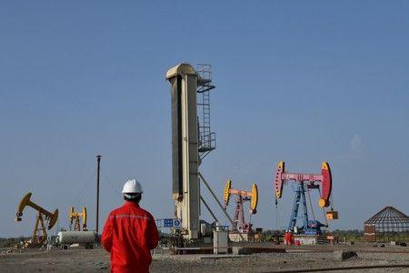 Công ty Trung Quốc ngừng mua dầu Venezuela vì ngán lệnh trừng phạt Mỹ - Ảnh 1.