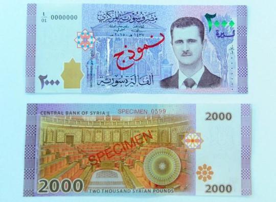 Syria in hình tổng thống Assad lên đồng nội tệ - Ảnh 1.