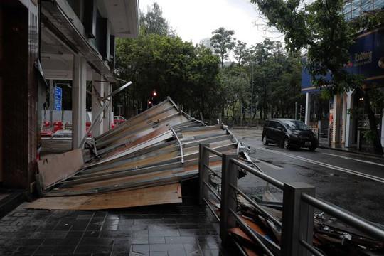 Chết kẹt trong bãi giữ xe vì bão Hato - Ảnh 9.