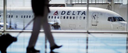 Hành khách bị chó cắn trọng thương trên máy bay - Ảnh 1.