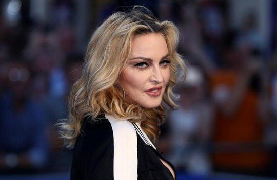 Madonna đến sống ở Bồ Đào Nha vì con nuôi - Ảnh 1.