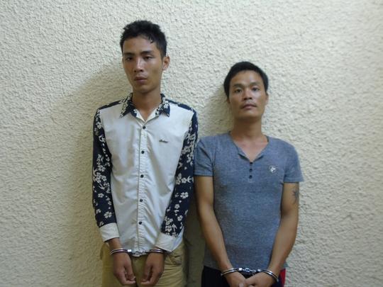Vụ đâm vào mặt tài xế, cướp taxi: Bắt 2 nghi phạm - Ảnh 1.