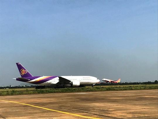 Đề nghị mở thêm cổng mới cho sân bay Tân Sơn Nhất - Ảnh 3.