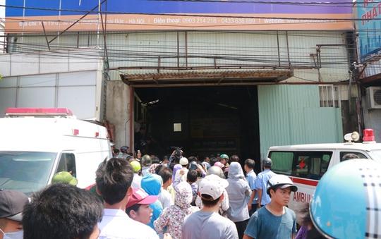 Cháy xưởng bánh kẹo ở Hà Nội, 8 người tử vong - Ảnh 10.