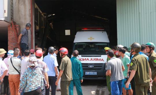 Cháy xưởng bánh kẹo ở Hà Nội, 8 người tử vong - Ảnh 14.