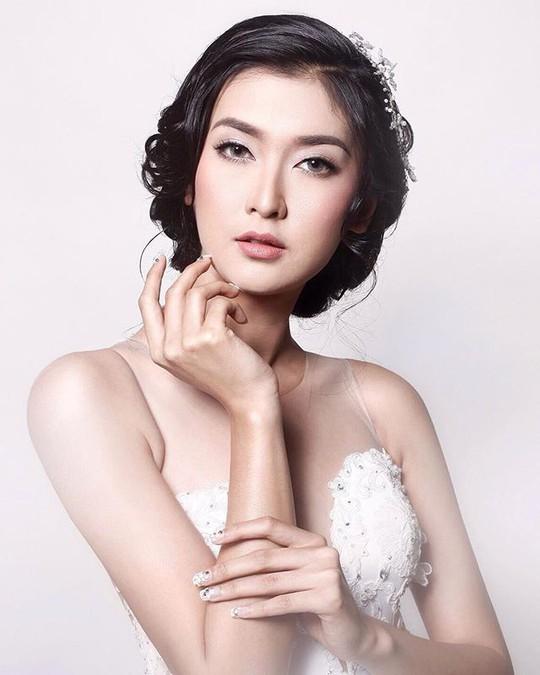 Cận cảnh nhan sắc tân Hoa hậu Quốc tế - Ảnh 6.
