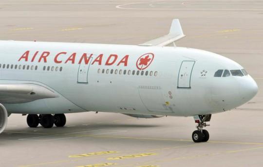 Hành khách dọa làm rơi cả máy bay vì người khác dám nhìn mình - Ảnh 1.