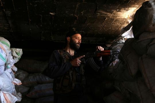 Syria ngừng bắn chờ đàm phán hòa bình - Ảnh 1.