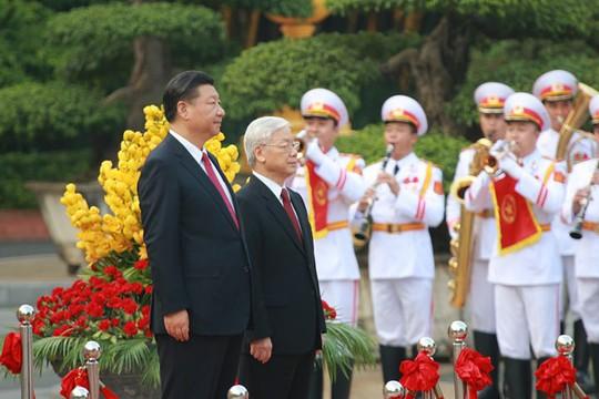 Bắn 21 loạt đại bác chào mừng Tổng Bí thư, Chủ tịch Tập Cận Bình - Ảnh 1.