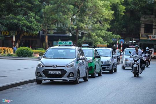 Taxi truyền thống kinh doanh kiểu Uber, Grab được không? - Ảnh 5.