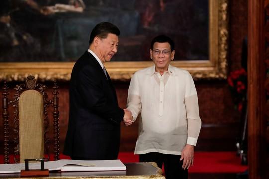 Philippines ký thỏa thuận thăm dò dầu khí với Trung Quốc - Ảnh 3.