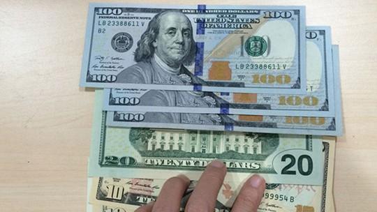Bán 100 USD, một chủ tiệm vàng bị phạt 40 triệu đồng - Ảnh 1.