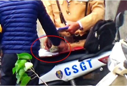Vụ CSGT nghi mãi lộ: Đình chỉ 6 đội trưởng, đội phó đội CSGT - Ảnh 1.