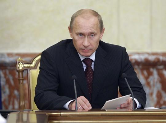 Nhìn lại Tổng thống Putin sau gần 2 thập kỷ nắm quyền - Ảnh 12.
