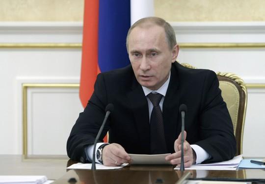 Nhìn lại Tổng thống Putin sau gần 2 thập kỷ nắm quyền - Ảnh 13.