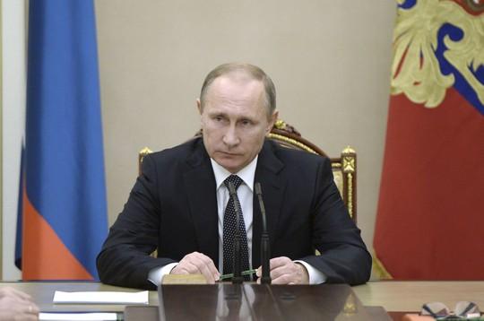 Nhìn lại Tổng thống Putin sau gần 2 thập kỷ nắm quyền - Ảnh 18.