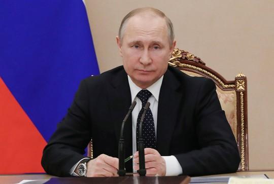 Nhìn lại Tổng thống Putin sau gần 2 thập kỷ nắm quyền - Ảnh 21.