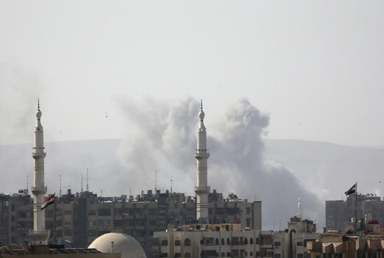 IS từ bỏ cứ điểm cuối cùng ở thủ đô Syria - Ảnh 1.