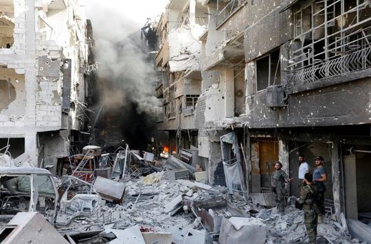 IS tấn công quân đội Syria ở Palmyra, 30 người thiệt mạng - Ảnh 1.