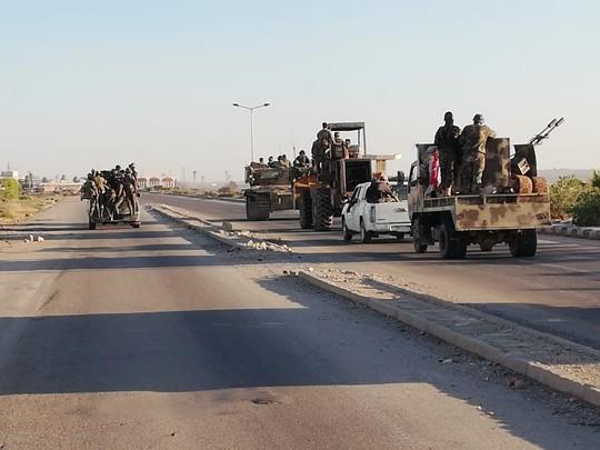 Bị tấn công quá dữ dội, phiến quân chịu đầu hàng ở miền Nam Syria - Ảnh 1.