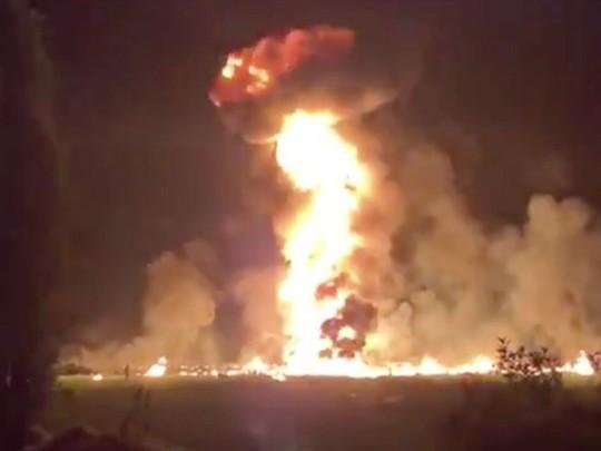 Hôi nhiên liệu từ ống dẫn rò rỉ, 66 người thiệt mạng đau đớn - Ảnh 2.