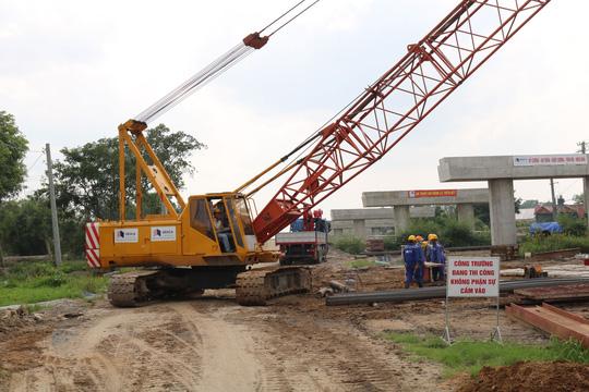 Dự án cao tốc Trung Lương - Mỹ Thuận chạy đua về đích - Ảnh 1.