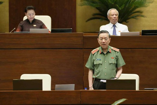 Bộ trưởng Bộ Công an Tô Lâm trả lời chất vấn trước Quốc hội - Ảnh 1.