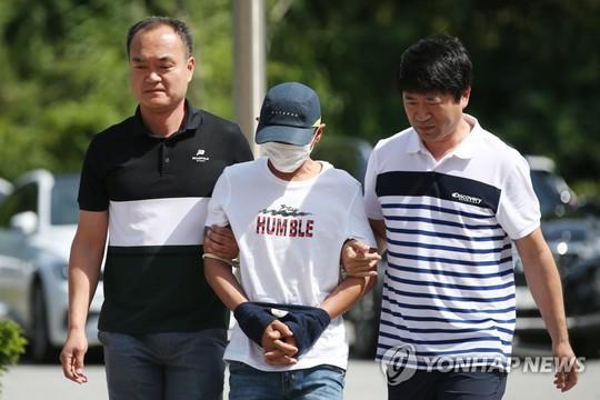 Hàn Quốc: Nghi phạm vụ đánh vợ Việt ra tòa - Ảnh 1.