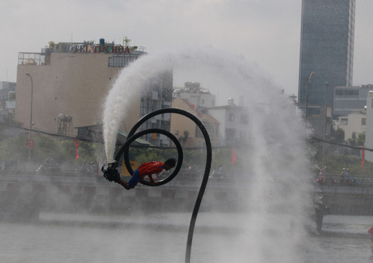 Tưng bừng đua thuyền rồng mừng Quốc khánh trên kênh Nhiêu Lộc - Ảnh 15.