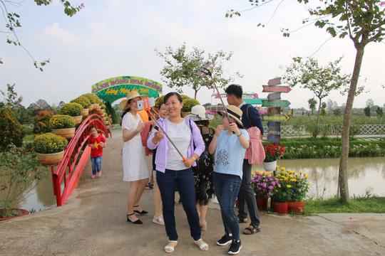 Ngắm làng hoa Sa Đéc ngày đầu tiên không thu vé vào cổng - Ảnh 3.