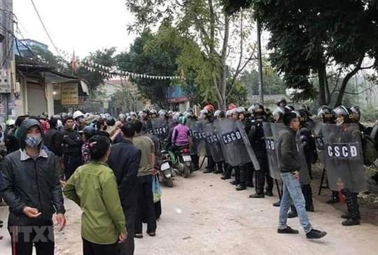 Vụ chống đối nghiêm trọng ở xã Đồng Tâm: Bác bỏ thông tin có nhiều hơn 3 công an hy sinh - Ảnh 1.