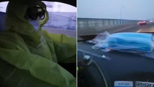 Trung Quốc: Tài xế taxi mặc bảo hộ kín mít, người dân đội thùng nhựa ra đường - Ảnh 1.