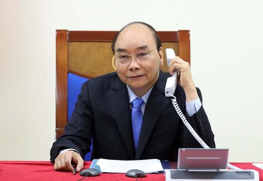 Thủ tướng Nguyễn Xuân Phúc điện đàm với Thủ tướng Nhật Bản Suga Yoshihide - Ảnh 1.