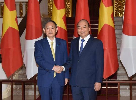 Thủ tướng Nguyễn Xuân Phúc chủ trì lễ đón Thủ tướng Nhật Bản - Ảnh 9.