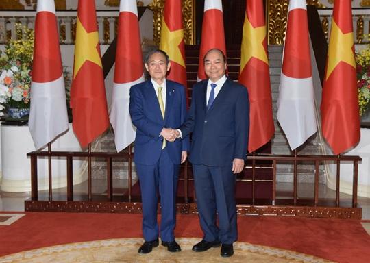 Thủ tướng Nguyễn Xuân Phúc chủ trì lễ đón Thủ tướng Nhật Bản - Ảnh 10.