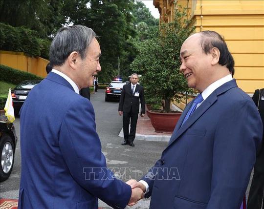 Thủ tướng Nguyễn Xuân Phúc chủ trì lễ đón Thủ tướng Nhật Bản - Ảnh 3.