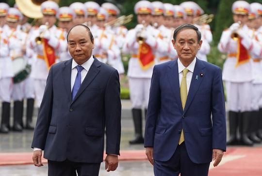 Thủ tướng Nguyễn Xuân Phúc chủ trì lễ đón Thủ tướng Nhật Bản - Ảnh 1.