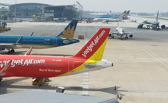 Hàng không Việt Nam thiệt hại hơn 10 ngàn tỉ đồng do dịch nCoV/Covid-19 - Ảnh 1.