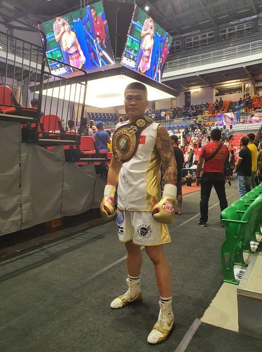 Thắng võ sĩ Thái Lan, Trương Đình Hoàng có 2 đai vô địch WBA - Ảnh 1.