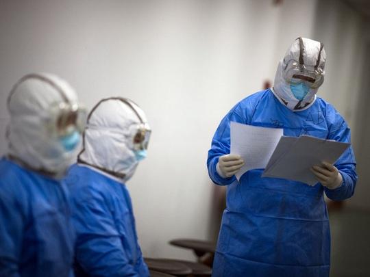 Covid-19: Trung Quốc lại thay đổi cách tính ca nhiễm, WHO nói bình thường   - Ảnh 1.