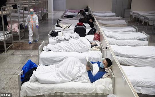Virus corona: Trung Quốc thi hành biện pháp mạnh tay ở Vũ Hán - Ảnh 1.