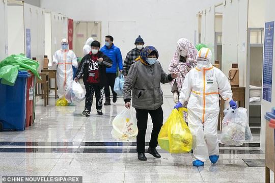 Virus corona: Trung Quốc thi hành biện pháp mạnh tay ở Vũ Hán - Ảnh 2.
