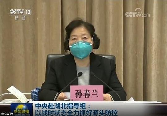 Virus corona: Trung Quốc thi hành biện pháp mạnh tay ở Vũ Hán - Ảnh 3.