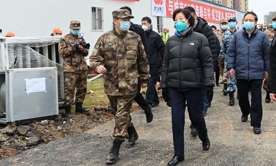 Virus corona: Trung Quốc thi hành biện pháp mạnh tay ở Vũ Hán - Ảnh 4.