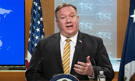 Bị Mỹ hạn chế thị thực các quan chức,  Trung Quốc phản ứng ra sao? - Ảnh 1.