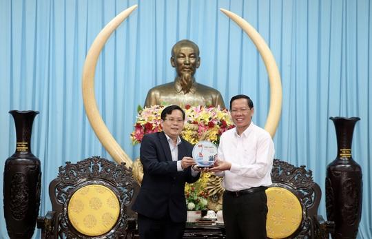 Bến Tre và Báo Người Lao Động sẽ hợp tác trên nhiều lĩnh vực - Ảnh 1.