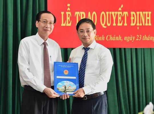 UBND TP HCM phê chuẩn nhân sự lãnh đạo tại quận 4 và huyện Bình Chánh - Ảnh 1.