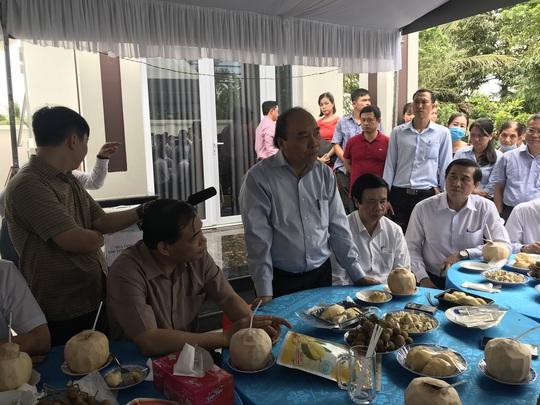 Thủ tướng thăm vùng chuyên canh sầu riêng ở Tiền Giang - Ảnh 1.
